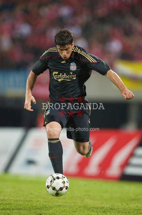 SINGAPORE, SINGAPORE - Sunday, July 26, 2009: Liverpool's Emiliano Insua in action against Singapore during a preseason friendly at the Singapore National Stadium. (Pic by David Rawcliffe/Propaganda)