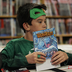 May 4, 2019 - Cincinnati, Ohio, USA - Sam  Myers looks over a Comic book on Sat May 4' 2019 at Rocking Rooster Comic and Game store In Cincinnati,Ohio  during Comic Book Day. (Credit Image: © Ernest Coleman/ZUMA Wire)