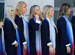 Ian Poulter's wife Katie Poulter (centre left), Rory McIlroy's wife Erica Stoll (centre) and Henrik Stenson's wife Emma Lofgren (centre right) as the European Team's wives and girlfriends line up for a photo before the Ryder Cup Opening Ceremony at Le Golf National, Saint-Quentin-en-Yvelines, Paris.