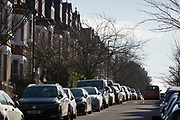 Cars parked along a residential street in Herne Hill SE24, on 10th February 2019, in London, England.