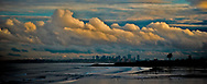 Dramatic clouds over Boston with Kings beach in the forground.