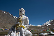 A white marble statue of buddha graces a shrine in the high Nubra Valley.