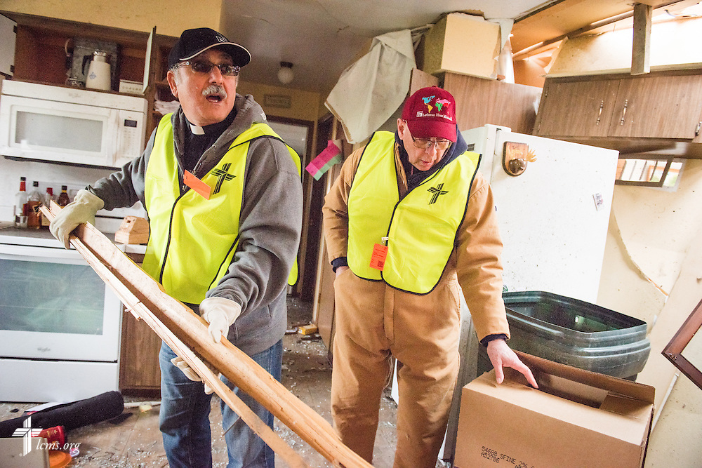 The Rev. Nabil Nour (left), LCMS Fifth Vice-President, helps remove debris from the parsonage next to Zion Lutheran Church on Monday, May 11, 2015, in Delmont, S.D. A tornado swept through the area the previous day and destroyed the church and nearby buildings. LCMS Communications/Erik M. Lunsford