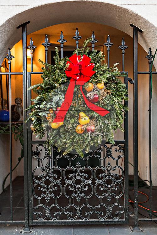 Christmas bows decorate an ironwork gate in historic Savannah, GA.