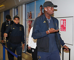 Paul Pogba of Manchester United is spotted on his way to catch a flight as the team fly to Turin on Tuesday afternoon to play Juventus in The Champions League on Wednesday night.
