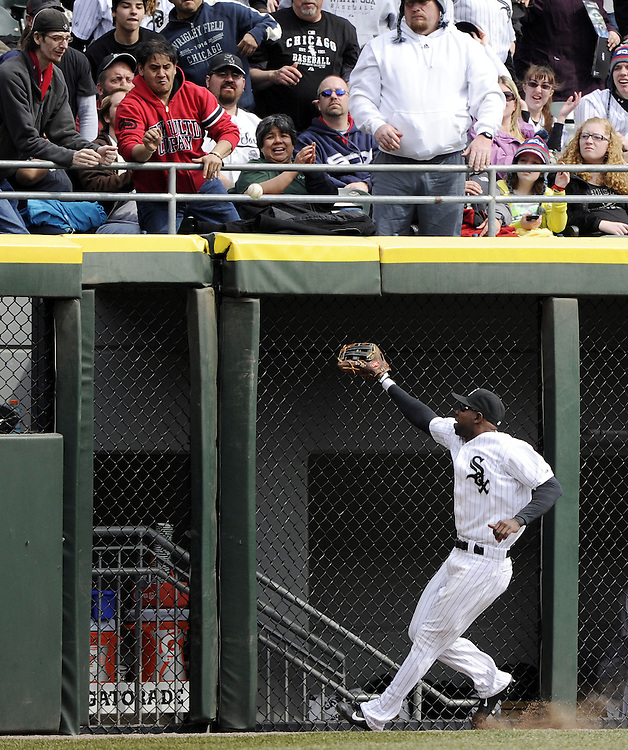 CHICAGO - APRIL 06:  Alejandro De Aza #30 of the Chicago White Sox watches a home run clear the fence, hit by  Michael Saunders #55 of the Seattle Mariners in the eighth inning on April 06, 2013 at U.S. Cellular Field in Chicago, Illinois.  The White Sox defeated the Mariners 4-3.  (Photo by Ron Vesely)   Subject:  Alejandro De Aza; Michael Saunders
