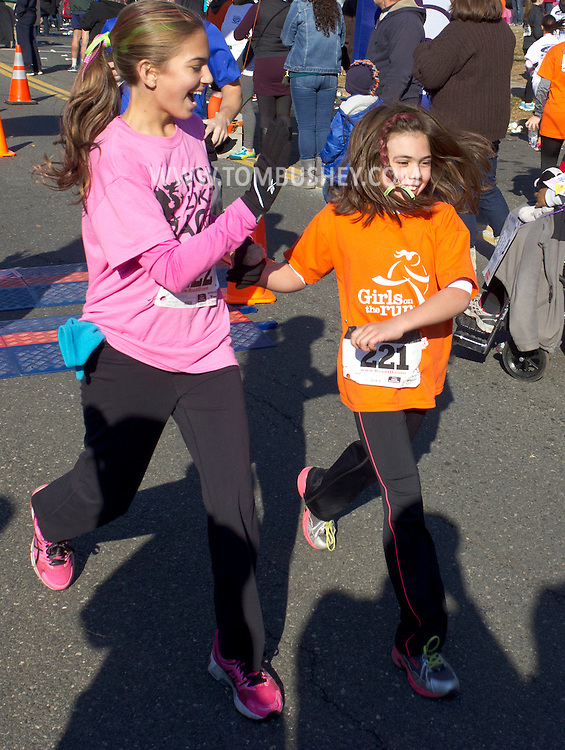 Cornwall-on-Hudson, New York - Girls in the Girls on the Run program at the  Cornwall Lions Club Fall Harvest Race on Nov. 10, 2013.