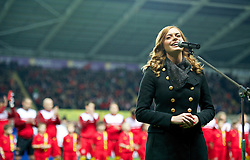 SWANSEA, WALES - Tuesday, March 26, 2013: Welsh singer Sophie Evans sings the national anthem before the 2014 FIFA World Cup Brazil Qualifying Group A match between Wales and Croatia at the Liberty Stadium. (Pic by David Rawcliffe/Propaganda)