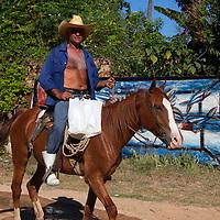 Central America, Cuba, Santa Clara. Cuban man on horseback.