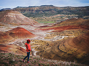 Aubrey McClaran hiking and exploring the Painted Hills Unit at the John Day Fossil Beds National Monument