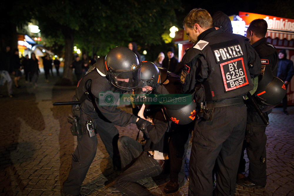 September 26, 2016 - PEGIDA marches during Oktoberfest towards refugee protest camp. As the racist movement reaches the cage to hold a rally on the way, police officers brutally push counter-protest off the cage. One person is pulled away at the head. The activist starts coughing and could barely breath. Only after twenty minutes an ambulance arrived. (Credit Image: © Michael Trammer via ZUMA Wire)