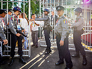 30 NOVEMBER 2017 - YANGON, MYANMAR: Myanmar police keep uncredentialed people out of the Cathedral before the Papal Mass at St. Mary's Cathedral in Yangon. Thursday's mass was his last public appearance in Myanmar. From Myanmar the Pope went on to neighboring Bangladesh.    PHOTO BY JACK KURTZ