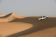 A 4x4 desert expedition vehicle climbs a sand dune at al-Galamun, near Dahkla Oasis, Western Desert, Egypt. The Western Desert covers an area of some 700,000 km2, thereby accounting for around two-thirds of Egypt's total land area. Dakhla Oasis is one of the seven oases of Egypt's Western Desert (part of the Libyan Desert). It lies in the New Valley Governorate, 350 km (220 mi.) and measures approximately 80 km (50 mi) from east to west and 25 km (16 mi) from north to south.