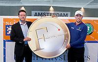 AMSTERDAM - Golfprofessional Floris de Vries (r) en NGF direkteur Jeroen Stevens openen de Amsterdam Golf Show 2012 in de Amsterdamse Rai. Foto Koen Suyk