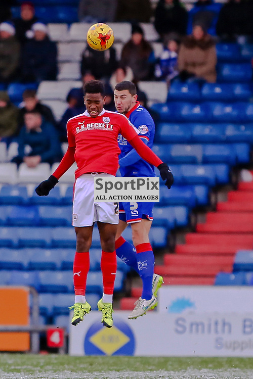 Josh Scowen of Barnsley  wins the header with James Wilson of Oldham Athletic during Oldham v Barnsley, Sky Bet League One, 21 November 2015,  (c) Jackie Meredith/SportPix.org.uk