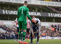 Football - 2016 / 2017 Premier League - Tottenham Hotspur vs. Southampton<br /> <br /> Fraser Forster of Southampton tries to unsettle Dele Alli of Tottenham before he takes a penalty at White Hart Lane.<br /> <br /> COLORSPORT/DANIEL BEARHAM