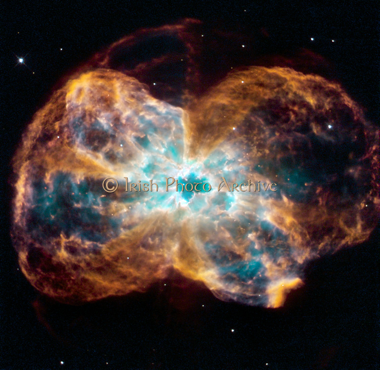 The star is ending its life by casting off its outer layers of gas, which formed a cocoon around the star's remaining core. Ultraviolet light from the dying star makes the material glow. The burned-out star, called a white dwarf, is the white dot in the center. Hubble Space Telescope (HST).