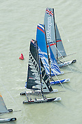 Emirates Team New Zealand, Gazprom Team Russia and JP Morgan jockey for position at the top mark. Day four of the Extreme Sailing Series regatta being sailed in Singapore. 23/2/2014