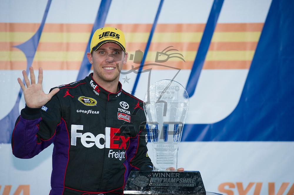Loudon, NH - SEP 23, 2012:  Denny Hamlin (11) wins the Sylvania 300 at New Hampshire Motor Speedway in Loudon, NH.