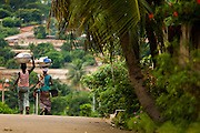 Women walk down a road in Dimbokro, Cote d'Ivoire on Friday June 19, 2009.