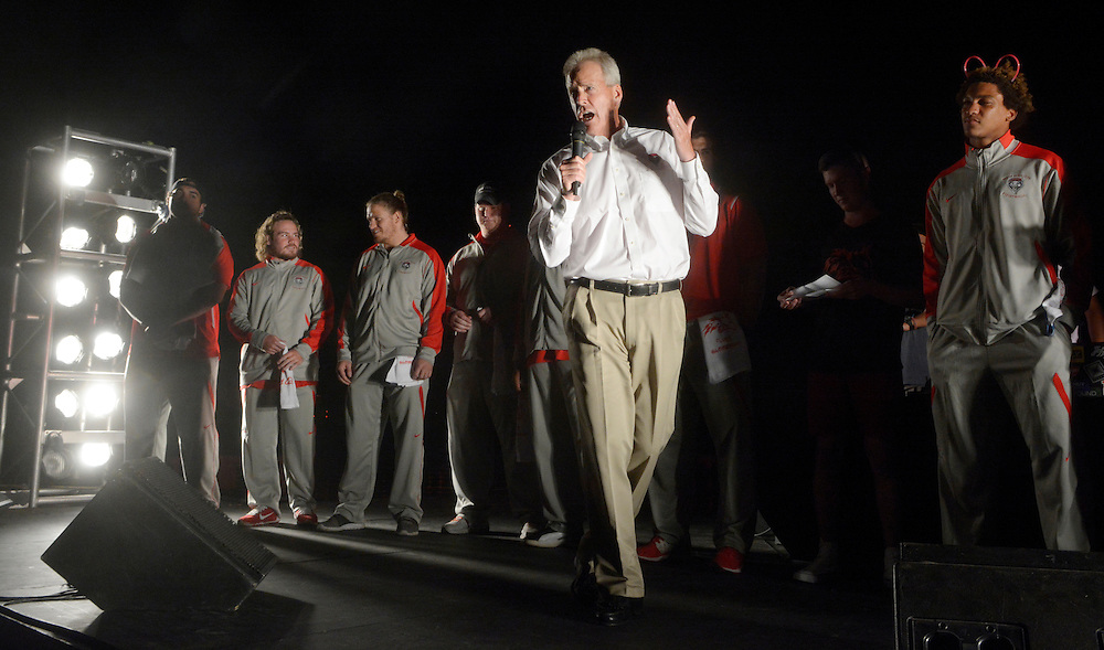 gbs090816t/SPORTS -- UNM football coach Bob Davie speaks to students  during the Red Rally on Johnson Field on the University of New Mexico campuson Thursday, September 8, 2016. (Greg Sorber/Albuquerque Journal)