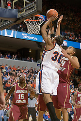 Virginia forward Adrian Joseph (30) shoots over Boston College center Tyrelle Blair (44).  The Virginia Cavaliers men's basketball team defeated the Boston College Golden Eagles 84-66 at the John Paul Jones Arena in Charlottesville, VA on January 19, 2008.
