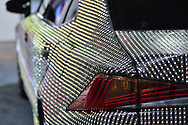 """Manhattan, New York, USA. April 12, 2017.  Closeup view of Lexus rear bumper lights and side area is shown of Lexus LIT IS 2017 sedan - covered with 41,999 tiny LED light units programmed to create changing patterns and colors - on display at the New York International Auto Show, NYIAS, at the Javits Center. The car had appeared during New York Fashion Week and is featured in UK artist Dua Lipa's music video for her song """"Be the One."""""""