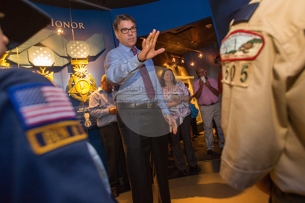 Former Texas Governor and GOP presidential hopeful Rick Perry speaks to a group of Boy Scouts before holding a town hall aboard the USS Yorktown June 8, 2015 in Mount Pleasant, South Carolina.