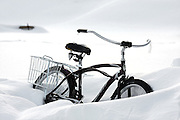 "SHOT 1/10/09 5:32:39 PM - A cruiser bike stuck in a snowbank in a backyard in Crested Butte, Co. Bikes are a popular form of transportation in the small mountain town even in the wintertime. Crested Butte is a Home Rule Municipality in Gunnison County, Colorado, United States. A former coal mining town now called ""the last great Colorado ski town"", Crested Butte is a destination for skiing, mountain biking, and a variety of other outdoor activities. The population was 1,529 at the 2000 census. The Colorado General Assembly has designated Crested Butte the wildflower capital of Colorado. The primary winter activity in Crested Butte is skiing or snowboarding at nearby Crested Butte Mountain Resort in Mount Crested Butte, Colorado. Backcountry skiing in the surrounding mountains is some of the best in Colorado. The mountain, Crested Butte, rises to 12,162 feet (3,700 m) above sea level..(Photo by Marc Piscotty / © 2009)"