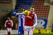 Wigan Gavin Massey (11) and Fleetwood Town Cian Bolger (12) during the EFL Sky Bet League 1 match between Wigan Athletic and Fleetwood Town at the DW Stadium, Wigan, England on 9 December 2017. Photo by Michał Karpiczenko.