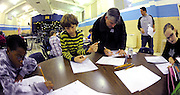 Sagamore Hills Elementary School parent volunteers help students work out problems during a Math Team session on Tuesday, Oct. 29, 2013, in Atlanta.  (David Tulis/dtulis@gmail.com)