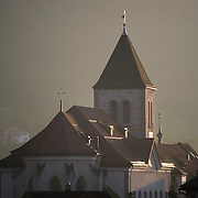 Appenzell, Switzerland, St. Mauritius church clock tower at sunset<br />