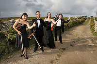 Galway Ensemble in Residence - ConTempo.On the way to the islands - - with Haydn & Mendelssohn!..The Galway Ensemble in Residence - Con Tempo, set off this morning for  Inis Oírr where they will begin their first ever County Galway tour, bringing the music of Haydn and Mendelssohn to the people of Galway in celebration of both composers whose bi-centenaries occurred this year. ..Pictured enroute to the Ferry at Rossaveal are:  Ingrid Nicola, violin, Bogdan Sofei, violin, Andreea Banciu, viola  and Adrian Mantu, 'cello..The tour will continue over the weekend in various venues throughout the county before the grand finale in St. Nicholas Church with classical guitarist John Feeley on Sunday night. Photo : Andrew Downes. Photo issued with compliments, no reproduction fee...Tickets for all concerts will be available at the door. Check your local venue for more information or log on to www.galwayensemble.ie.