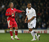 Photo: Paul Thomas.<br /> Blackburn Rovers v Basle. UEFA Cup. 02/11/2006.<br /> <br /> Tugay (L) of Blackburn and Delron Buckley watch as Tugay's long range attemnp at goal goes in.