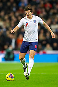 England defender Harry Maguire on the ball during the UEFA European 2020 Qualifier match between England and Montenegro at Wembley Stadium, London, England on 14 November 2019.