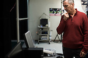 Dr. Peter Weyland checks the computer while Ryan Hall runs at the SMU Locomotor Performance Lab in Dallas, Texas on March 18, 2016. (Cooper Neill for The New York Times)