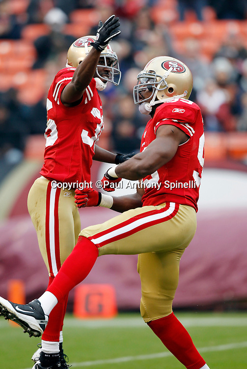 San Francisco 49ers linebacker Manny Lawson (99) celebrates with San Francisco 49ers cornerback Shawntae Spencer (36) after a first quarter sack during the NFL week 17 football game against the Arizona Cardinals on Sunday, January 2, 2011 in San Francisco, California. The 49ers won the game 38-7. (©Paul Anthony Spinelli)
