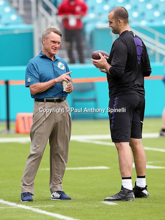 Miami Dolphins senior offensive assistant Al Saunders talks to Baltimore Ravens quarterback Matt Schaub (8) before the 2015 week 13 regular season NFL football game against the Miami Dolphins on Sunday, Dec. 6, 2015 in Miami Gardens, Fla. The Dolphins won the game 15-13. (©Paul Anthony Spinelli)