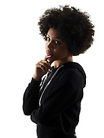 one mixed race african young teenager girl woman serious portrait in studio shadow silhouette isolated on white background