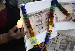November 10, 2018 - Kolkata, West Bengal, India - Congress activists hold replica of demonetize bank note, poster, flameless LED candles and shout slogan to protest against Union Government on the occasion of second anniversary of demonetization. (Credit Image: © Saikat Paul/Pacific Press via ZUMA Wire)