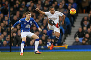 Swansea City midfielder Wayne Routledge beats Everton defender John Stones to the ball during the Barclays Premier League match between Everton and Swansea City at Goodison Park, Liverpool, England on 24 January 2016. Photo by Simon Davies.