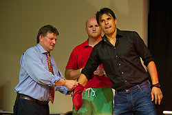 MACHYNLLETH, WALES - Tuesday, July 9, 2013: Wales' manager Chris Coleman helps make the draw for the Welsh Cup before a Question & Answer session with supporters after a charity football match in aid of the April Jones Fund. (Pic by David Rawcliffe/Propaganda)