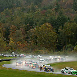 The Freedom Autosport Mazda MX-5 driven by Tom Long and Derek Whitis leads at the start of the Grand-Am Continental Tire Sports Car Challenge ST race at Lime Rock Park in Lakeville, Conn.
