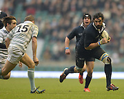 Twickenham. UK.   Oxford's, Captain and man of the match, running with the ball during the 2013 Varsity Rugby Match, defeating Cambridge 33 - 15 on    Thursday  12/12/2013, at the RFU Stadium.  Surrey, England  [Mandatory Credit. Peter Spurrier/Intersport Images]
