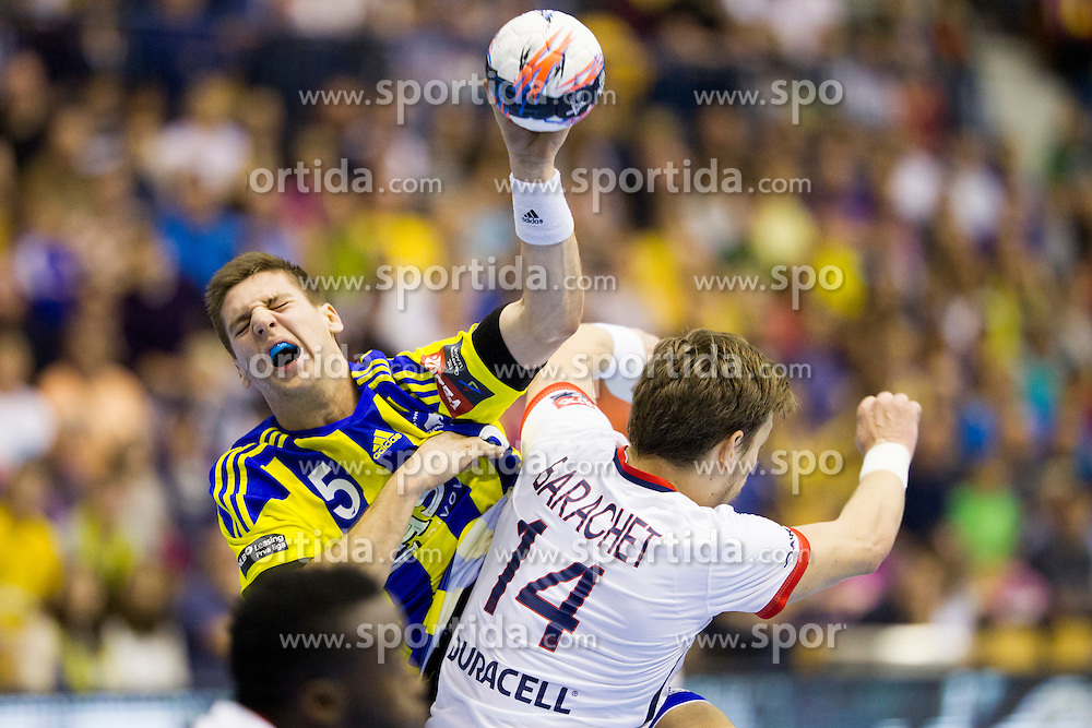 Sime Ivic of RK Celje Pivovarna Lasko and Xavier Barachet of Paris Saint-Germain during handball match between RK Celje Pivovarna Lasko (SLO) and Paris Saint-Germain (FRA) in Round #5 of Group Phase of EHF Champions League 2015/16, on October 18, 2015 in Arena Zlatorog, Celje, Slovenia. Photo by Urban Urbanc / Sportida