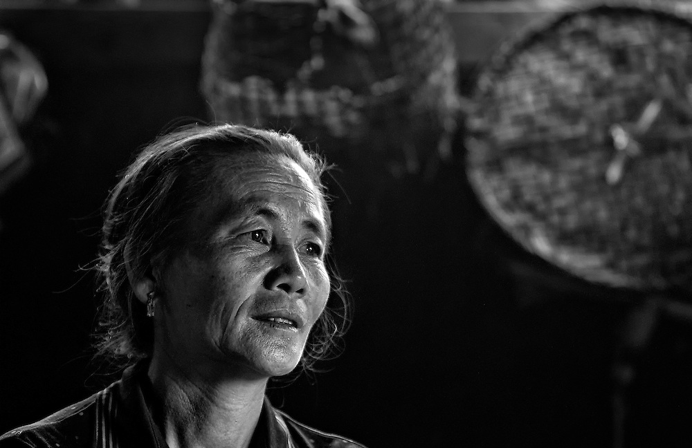 A Hmong woman in her kitchen in the mountains near Luang Prabang, Laos.