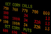 Trade of grain, rice, corn, soybeans and cotton at the CME, Chicago Merchantile Exchange. Stockpiling of wheat and rice have made farmland an attractive investment and opened up for speculation.