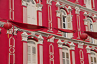 Bright red colonial building facade in Chinatown, Singapore