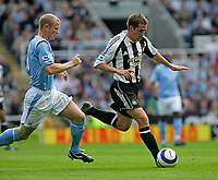Photo: Andrew Unwin.<br />Newcastle United v Manchester City. The Barclays Premiership. 24/09/2005.<br />Manchester City's Ben Thatcher (L) chases after Newcastle's Michael Owen (R).