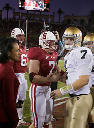 November 28, 2009; Stanford, CA, USA;  Stanford Cardinal running back Toby Gerhart (7) and Notre Dame Fighting Irish quarterback Jimmy Clausen (7) meet with Condolezza Rice before the game at Stanford Stadium.